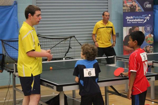 Adam Thompson coaching children